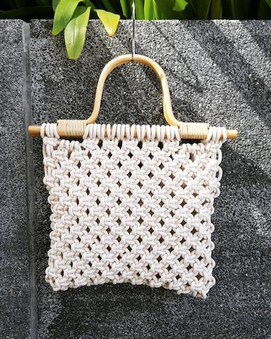 white macrame bag rattan handle